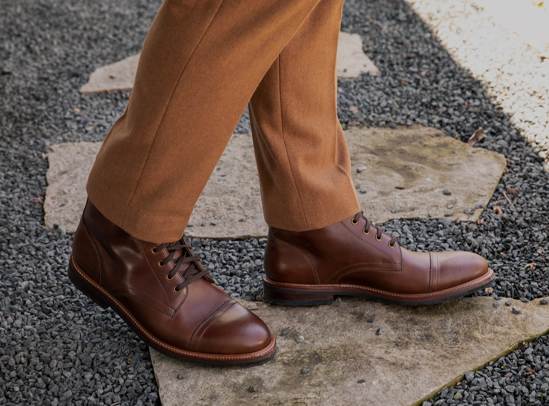The featured shoe in this image is the Postino Cap Toe Oxford in Cognac. Click to learn more about each brand in the Weyco portfolio.