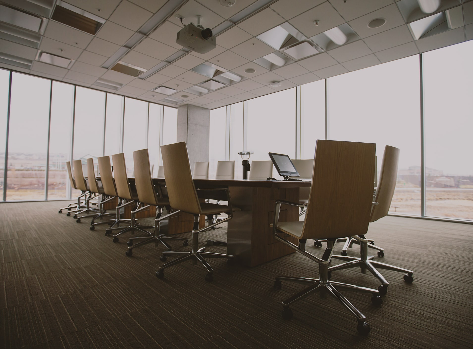 The featured image is a board room with multiple chairs. Click to learn more about Weyco and its relevant investor information.