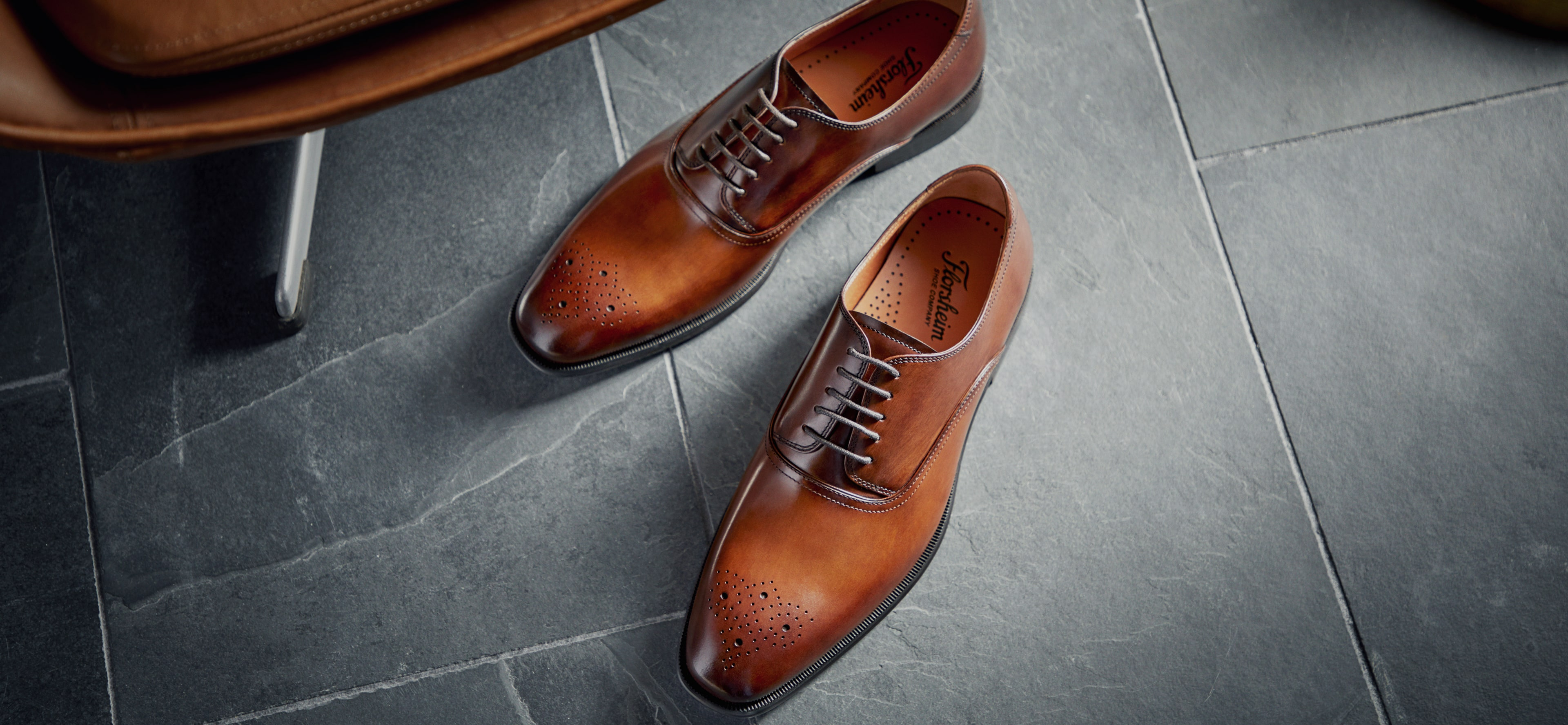 The featured shoe in this image is the Highland Canvas Plain Toe Oxford in Navy.